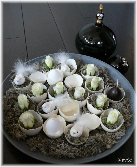 Easter scale - white eggs, birds, roses, candles in the shape of an egg and grey moss