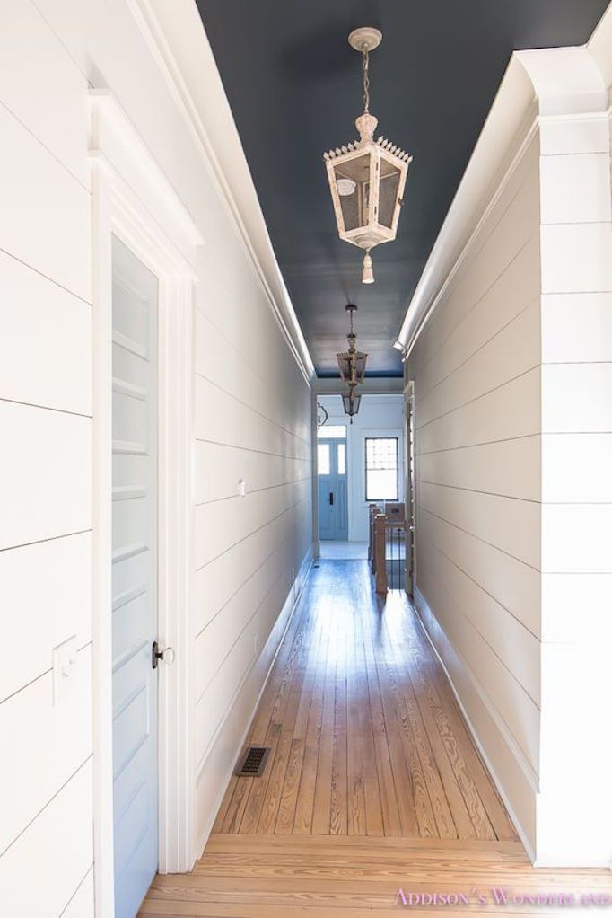 shiplap hallway with dark ceiling
