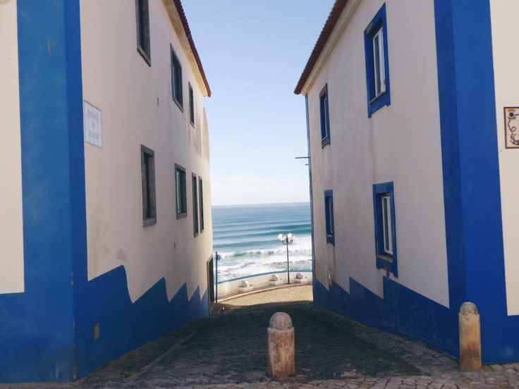 Watching the waves roll in through the iconic houses in the centre of Ericeira
