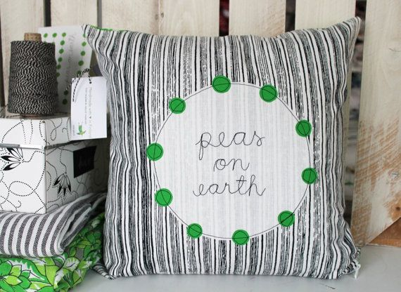 peas on earth - appliquéd cushion cover. €40.00, via Etsy.
