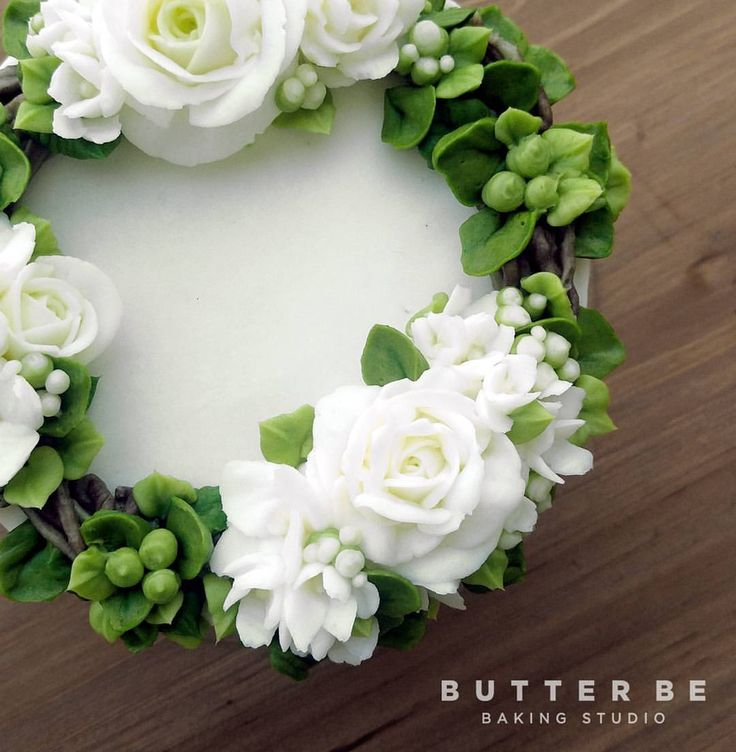 green and white buttercream flowers and leaves