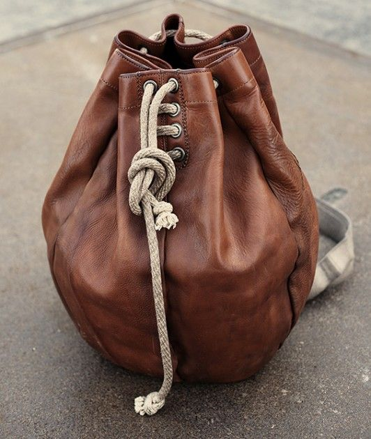 leather drawstring bag/purse - love the leather treatment, but I like bags to close (zip) at the top.