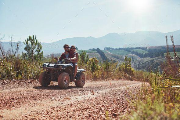 Couple On Holiday Enjoying On A Atv Bike Ride Bike Ride Atv