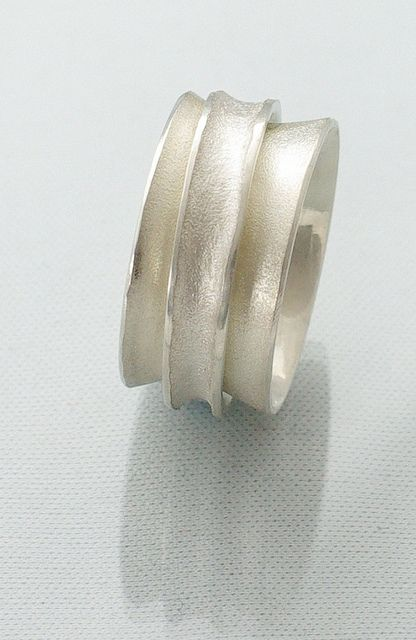 Textured silver anticlastic swivel ring
