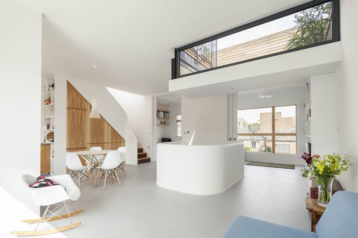 Gransden Avenue. central stair case splits the main living floor into kitchen, sitting, play/library and studio/office. large pocket doors can open or close the spaces to each other