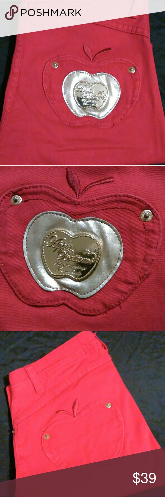 """Rare Apple Bottom Jeans Size 5/6 These Red Apple Bottom Jeans are so shapely that they show off all of your natural curves.  The back pockets are in the shape of an apple and there is a gold apple emblem on the back right pocket and a small gold apple on the left front pocket. There are gold rivets on the front and back also a large gold button above the front zipper. They are size 5/6 and made out of  97% cotton and 3% spandex  Measurements:   Waist- 14"""" Thigh- 9"""" Inseam- 33"""" Front Rise- 8""""…"""