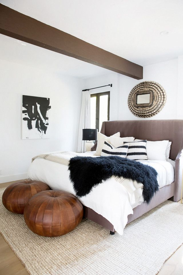 "On the guest house guest room: ""Again, we wanted to make all guest rooms gender-neutral. We created a more handsome palette here with cognac leather poufs, a black curly lamb throw, and a taupe..."