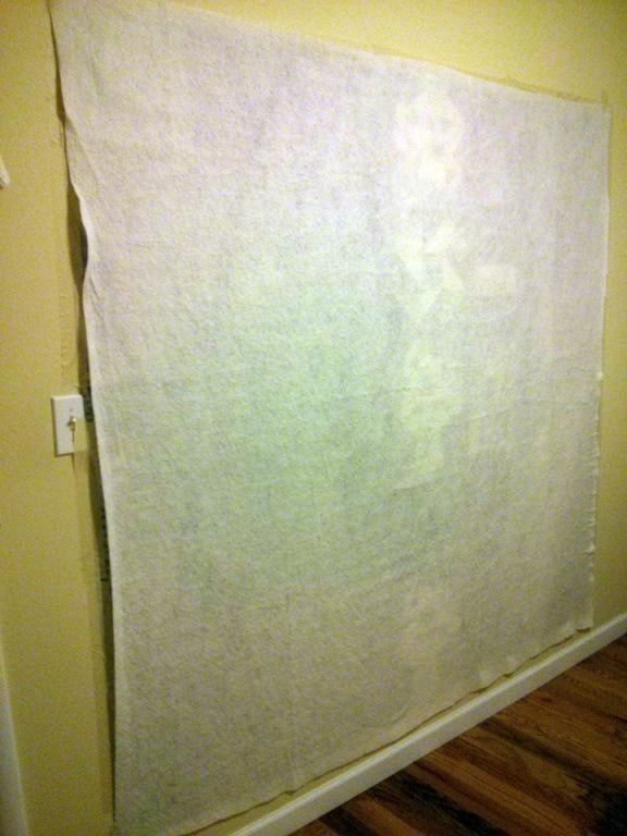 Basting a quilt on the wall works quite well. You don't have to crawl around on the floor to get your quilts basted!