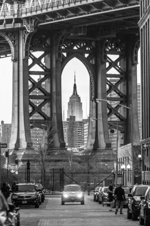 The Empire State Building framed by the Brooklyn Bridge.