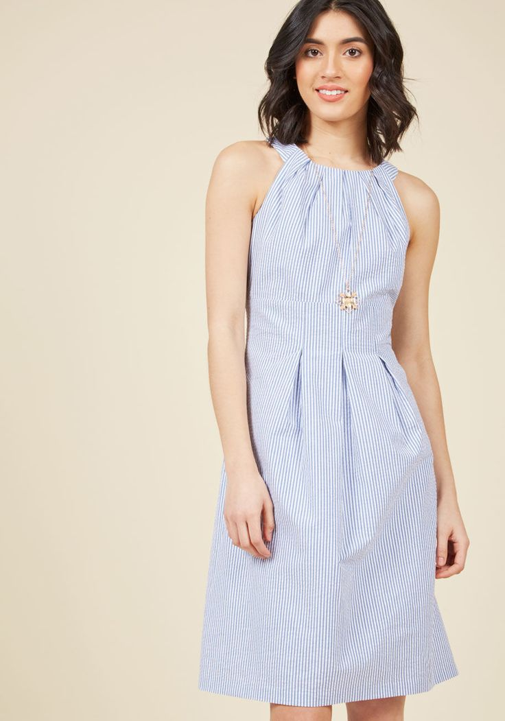 <p>Entertaining your pals with a barbecue at your warm-weather getaway calls for this seersucker dress by Nine West! Pleats top the neckline and cascade from the vertical skirt seams of this blue-and-white striped A-line, offering up a polished look worthy of your party planning prowess.</p>