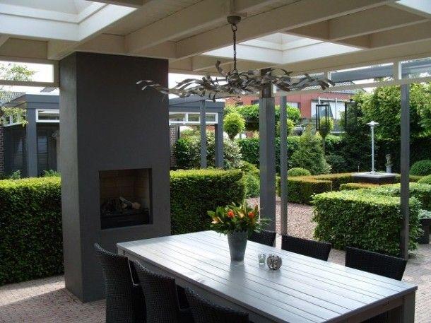 Serre, uitbouw en overkapping | klassieke veranda met haard Door Tamara