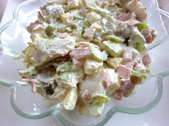 This German herring salad is from Bremen also contains bologna, apple and pickle pieces tossed together and smothered in a creamy curry sauce.