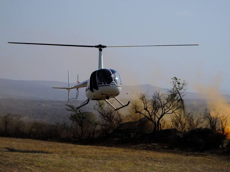 The fantastic chopper pilot brings her in to land... Photo by Carol Harnwell  www.youthrhinosummit.com #rhino #poaching #wildlife