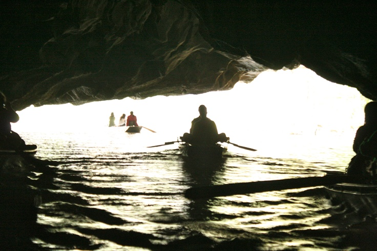 Going through a cave on rowboats in Tam Coc, VietnamPlaces Travel, Tam Coc