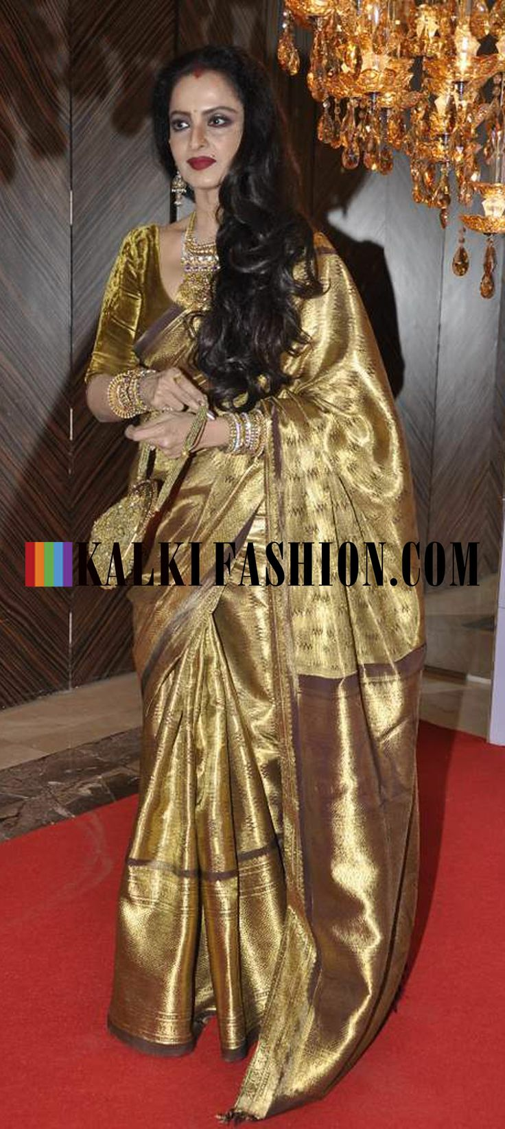 http://www.kalkifashion.com/  Rekha as ever looks gorgeous in her tradutional gold saree at Hello! Hall of Fame Awards 2013.