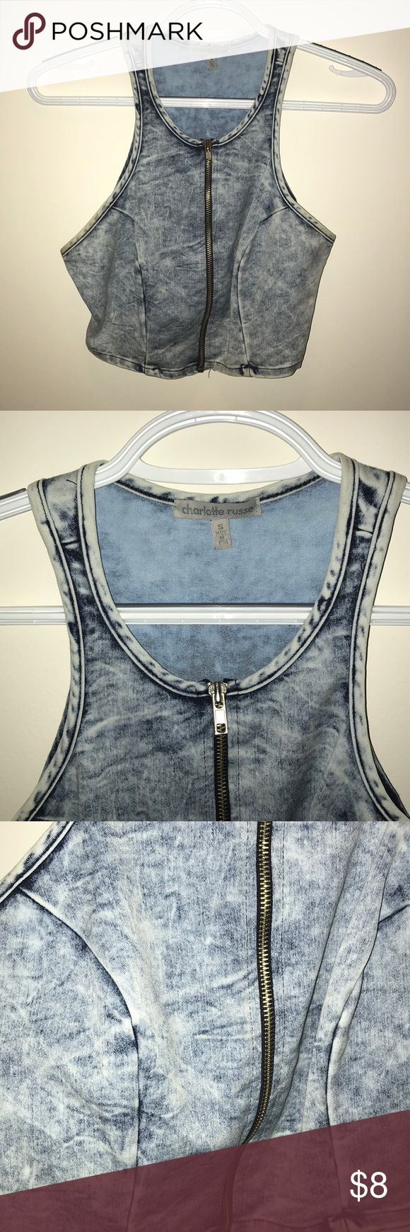 Denim Zip Up Halter Crop Top Worn twice, denim halter zip up crop top from Charlotte Russe hugs the body in a flattering way, and has just enough length to show a good amount of stomach Charlotte Russe Tops Crop Tops