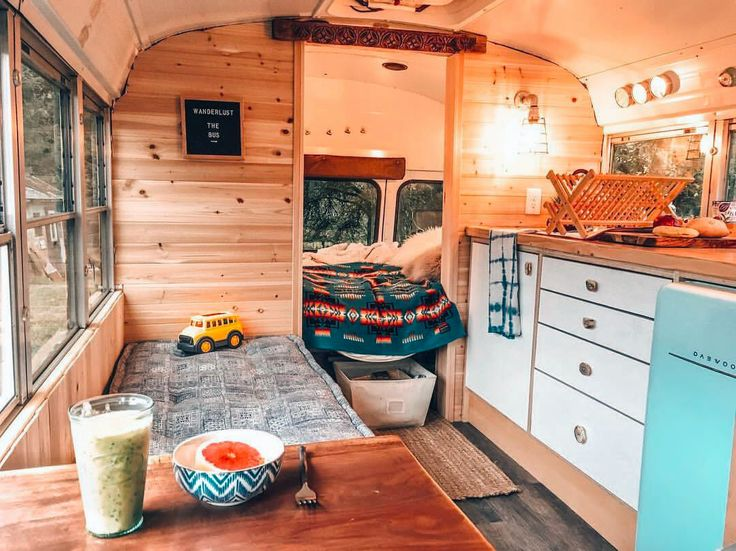 Cozy campervan conversion that would be perfect for our family. I love all of the interior storage!