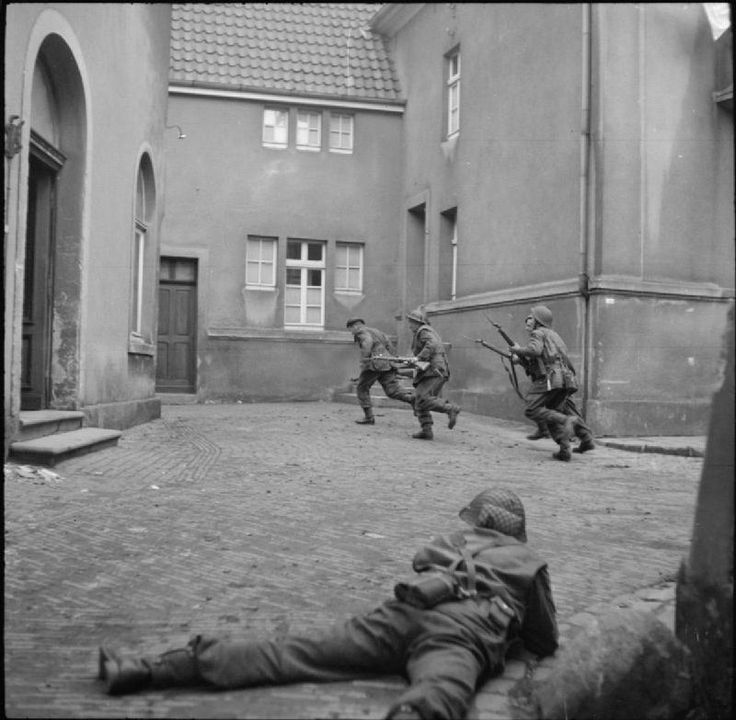 BRITISH ARMY NORTH-WEST EUROPE 1944-45 (BU 3165)   Infantry of 3rd Division clearing out snipers in the town of Lingen, 7 April 1945.
