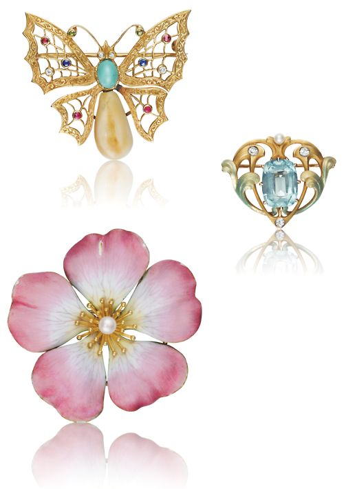 This lot of three Art Nouveau brooches was listed in a recent Phillips auction.