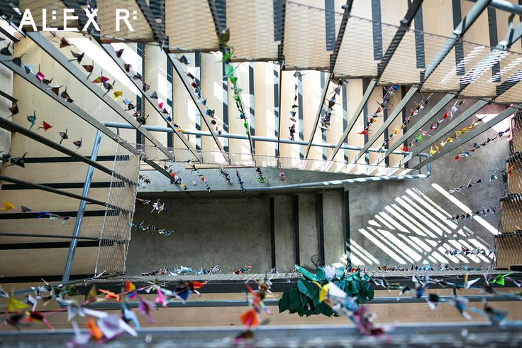 Colourful wedding: 1000 paper cranes hanging in the stairwell