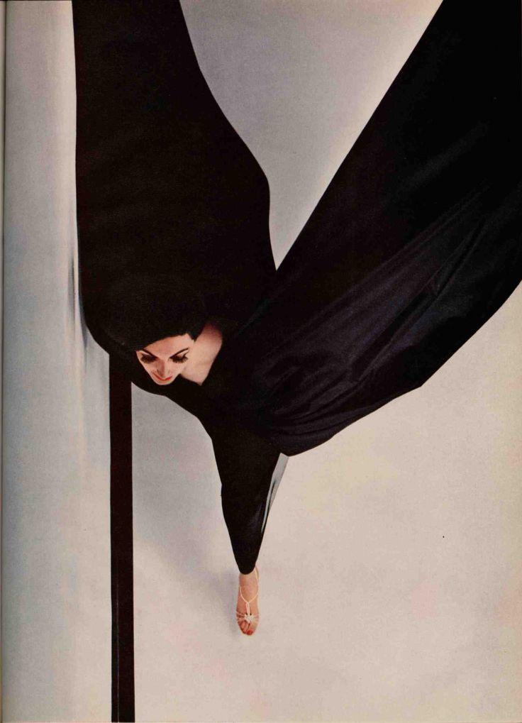 Hiro, Black evening dress in flight, 1963