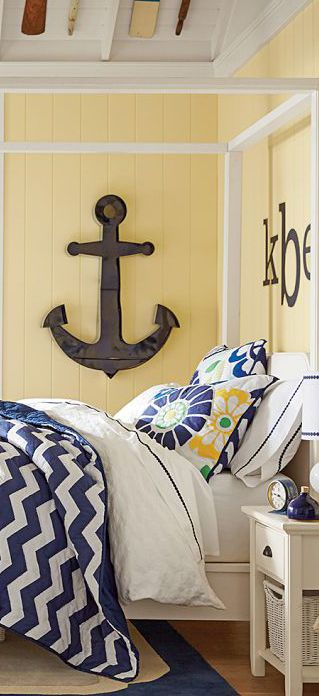 Fi's butter yellow room with dark wood accessories, blues & cream colors.