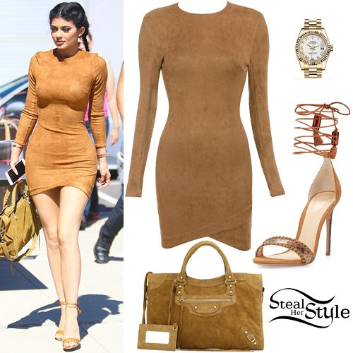 Kylie Jenner was spotted leaving a studio in Culver City today wearing a Mistress Rocks Gunsmoke Tan Suedette Asymmetric Dress ($92.00), her Rolex Lady-DateJust Oyster Yellow Gold Watch (Not available online), a Balenciaga Classic City Suede Tote Bag ($1,835.00) and a pair of Alexandre Birman Toni Sandals ($795.00).