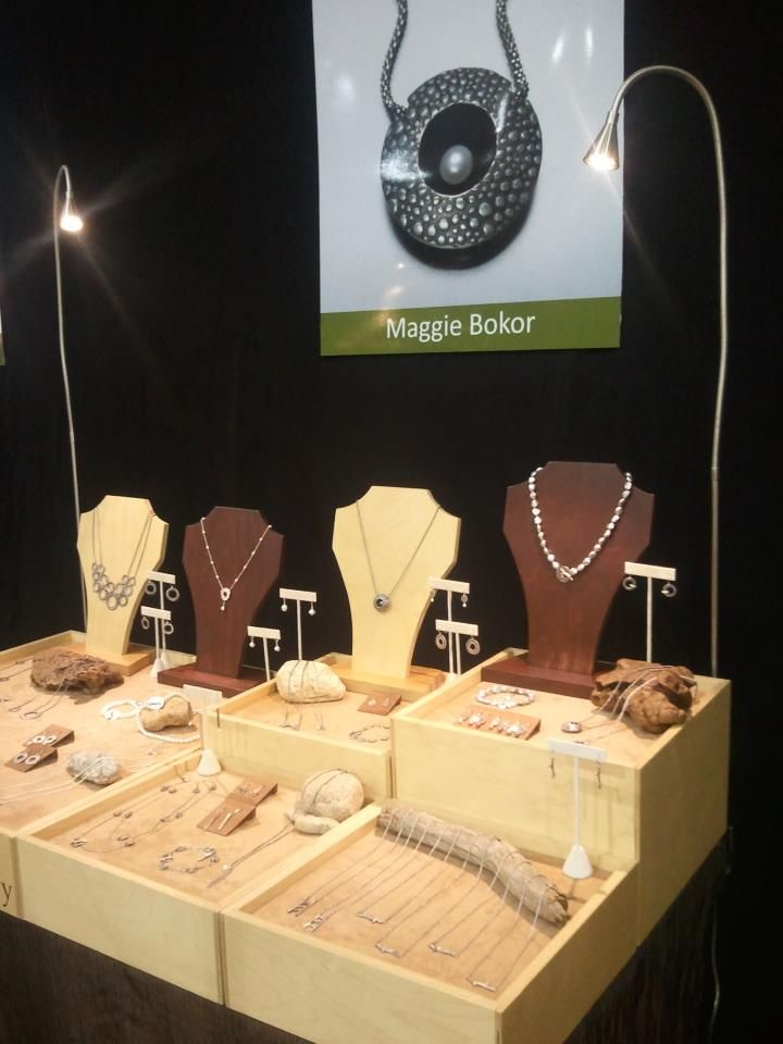 Beautiful use of varied heights and T-bar displays! Maggie Bokor, jewelry display.