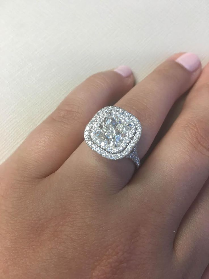 Talk about sparkle! This engagement ring accentuates its large center stone with a glamorous double halo.