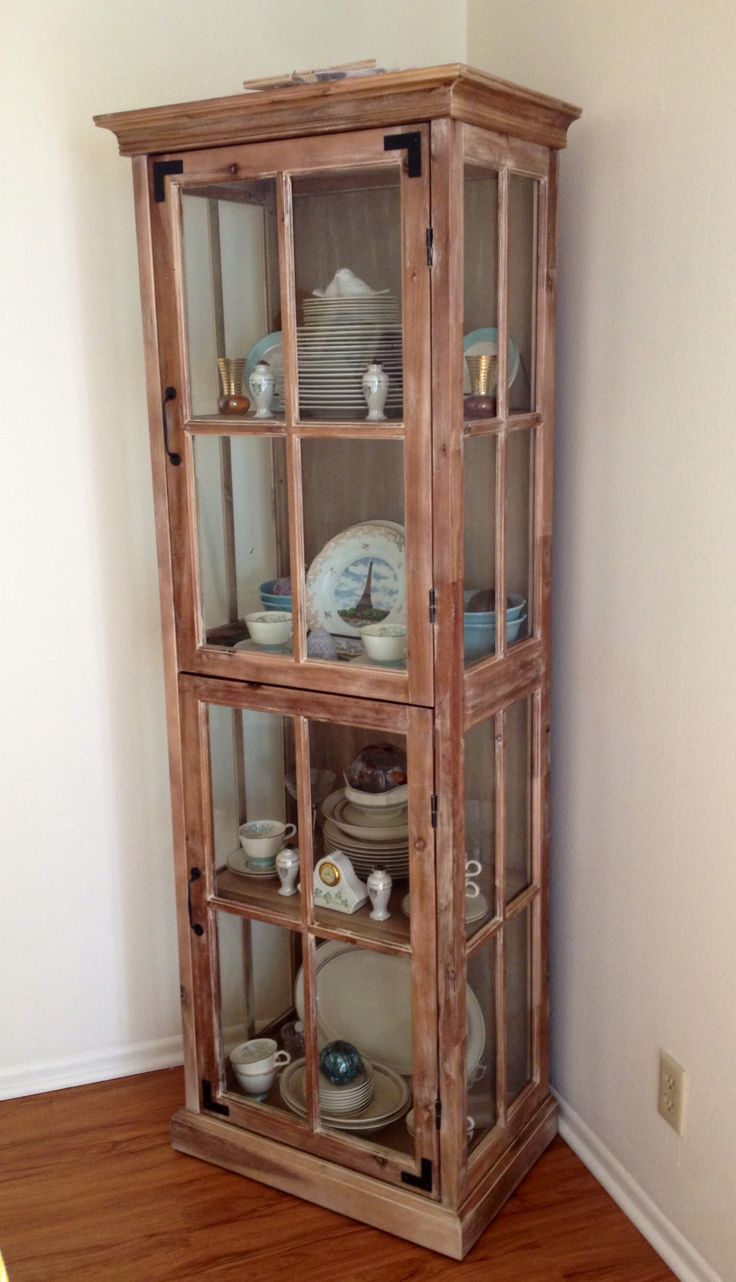 Cost plus world market curio cabinet used as china hutch for Dining room china cabinet ideas