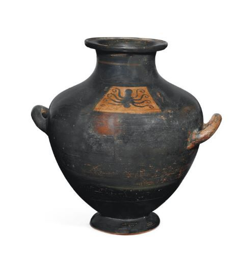 Attic black-figured kalpis, late 6th century B.C.  Black-glazed except for a trapezoidal panel on shoulder, with octopus with four curling tentacles on each side of its body, 31 cm high. Private collection