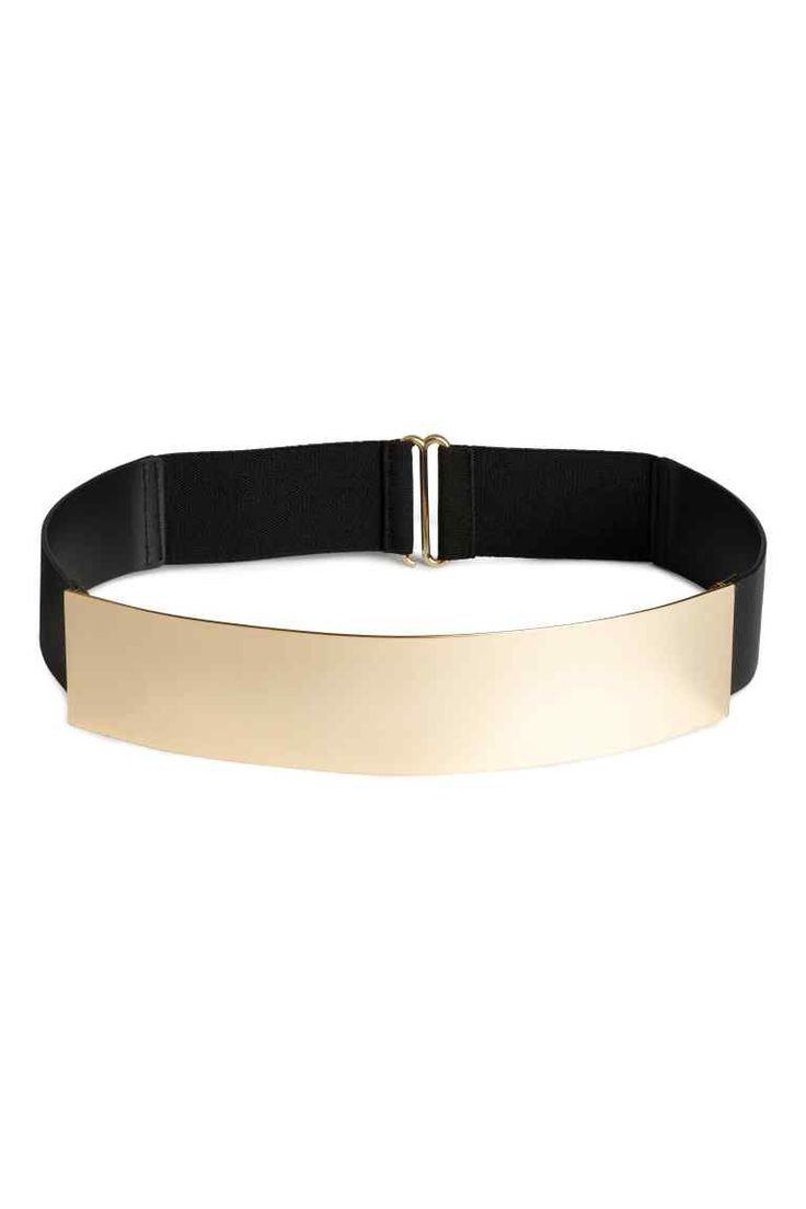 Cinturón ancho: Cinturón ancho en metal y piel sintética con elástico y cierre de metal detrás. Ancho 5 cm.