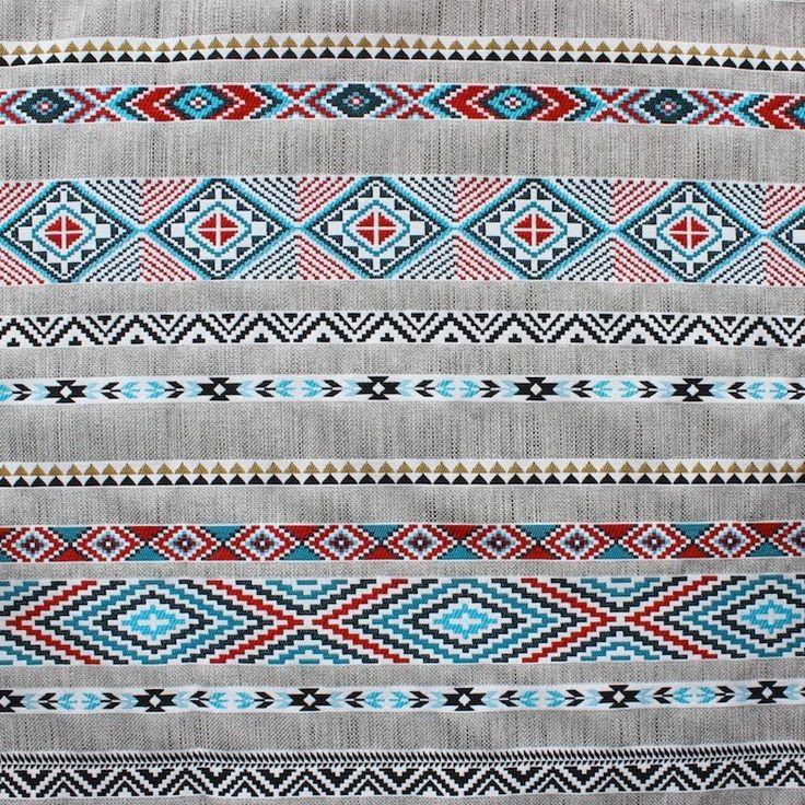 Tissu en coton, polyester et lin à motif ethnique bleu et rouge sur fond gris