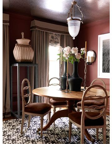 To give his small dining room luxurious warmth, Eric Cohler covered Gustavian chairs in Edelman Chocolate suede, painted the walls Farrow  Ball Eating Room Red, and covered the ceiling in Lee Jofa tea paper.