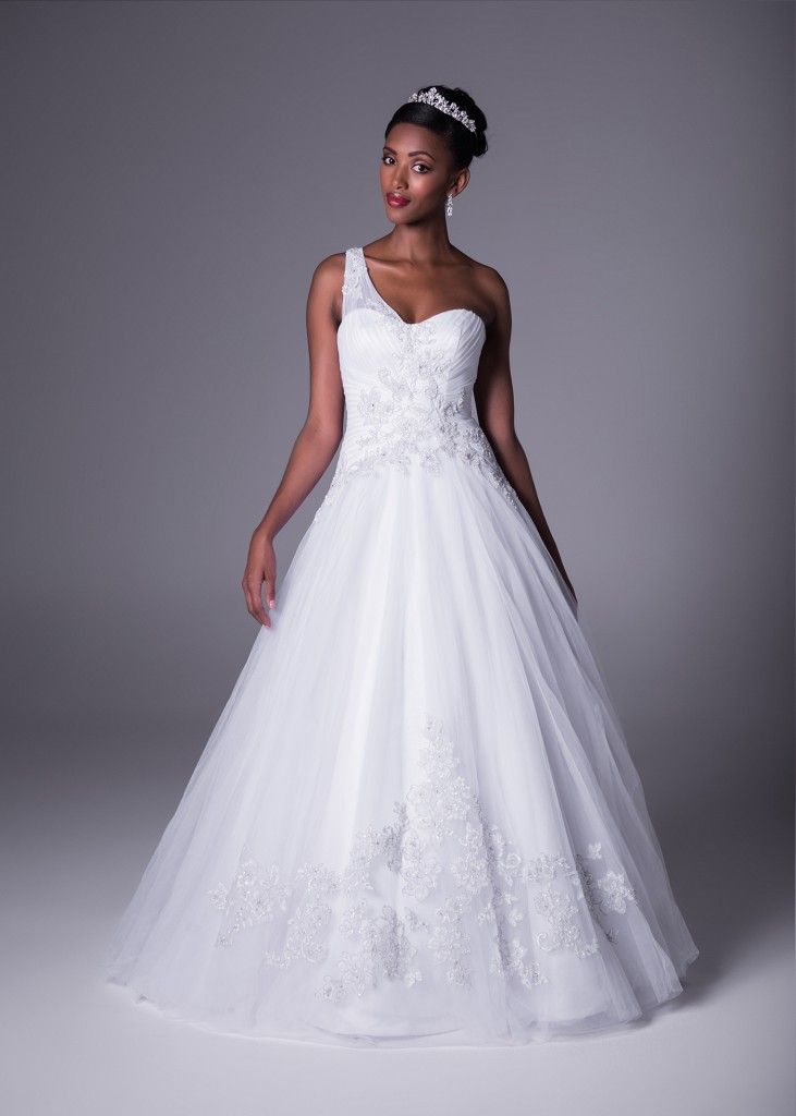 The picture of perfection. This one shoulder ivory tulle gown with embellished details draws attention to all the right places. Designed by Oleg Cassini, available exclusively at Bride&co South Africa (Style CKP421) Click to Book a Fitting.