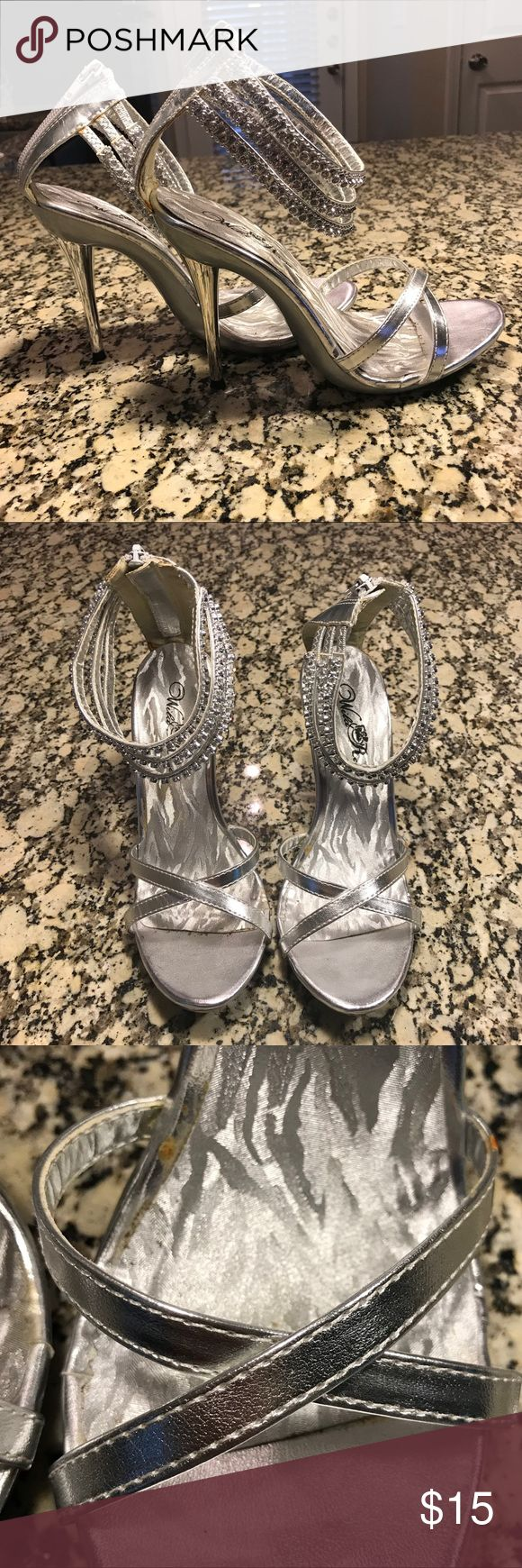 Silver Prom Heels Beautiful silver heels perfect for any special occasion! There are some marks on the shoes and is shown in the pictures. Only worn once for prom. Shoes Heels