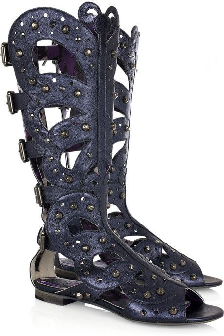 Anna Sui boots have an open toe, cutout detail at sides and on main boot, perforated detail on main boot, buckles at back to adjust the size and a zip fastening on the back. Metallic-blue leather flat gladiator boots with butterfly design and burnished-silver studding. Designer color: English Blue.    For more stylish Anna Sui boots, please visit this link: Anna Sui Women Boots