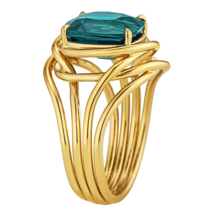 Tiffany & Co. Schlumberger Indicolite Tourmaline Gold Ring. This 3.68 carat cushion cut indicolite tourmaline is the velvety blue/green color of a royal peacock. Mounted atop four 18 karat yellow gold organically intertwined gold ropes, this precious gemstone's color is dreamy to look at and magical to wear