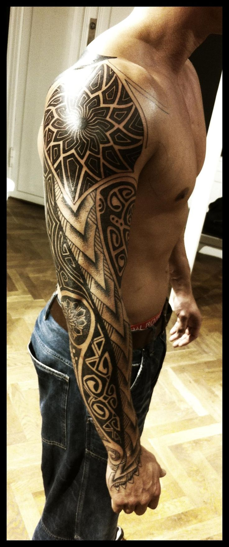 Tahiti tribal polynesian tattoo sleeve with a bold flower