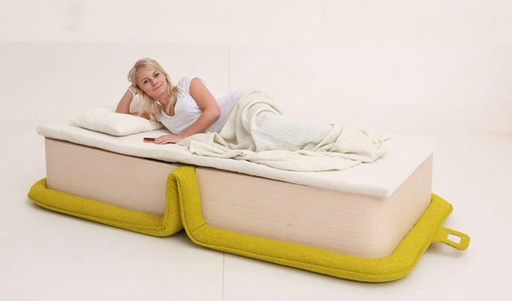 """Elena Sidorova, designer from Moscow, Russia, has multifunctional arm chair called flOP. """"Flop is an armchair which folds out to a sleeping place for 1 person. It has construction made of veneer and upholstery made of 100% sheep wool material. The sleeping place has elastic straps as a base. Matras and pillow storage is inside."""" …"""