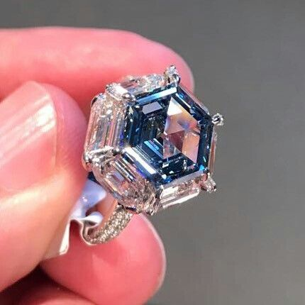 A fancy intense blue diamond and diamond ring, by Etcetera. G.c.FIEND/ti. This is a stunner