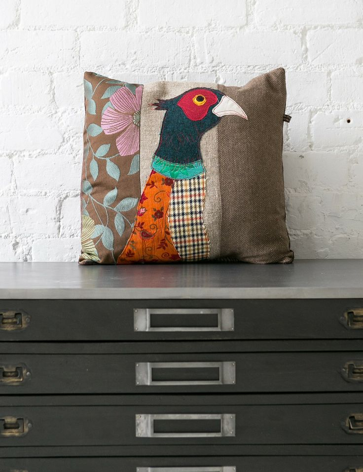 We are so excited to introduce these patchwork textile animal cushions to our range of homewares. Crafted in an applique style with pieces of plain and patterned fabric, they incorporate traditional colours and designs in a completely new way, with the creation of these distinctive animal images. Jazz up an armchair or sofa in an instant with the addition of one or more of these truly characterful cushions.
