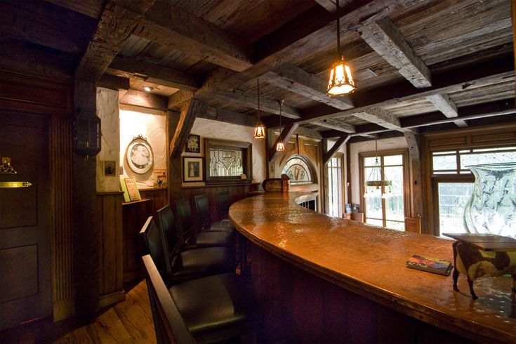 Home for Sale with an Irish Pub on Lower Level! Luxury home in gorgeous park-like setting features a custom-built pub with authentic post and beams, stone fireplace, leaded windows and a billiards room...sure to be the hit of every party! #irishpub #realestate #milliondollarhomes MLS# 3622819