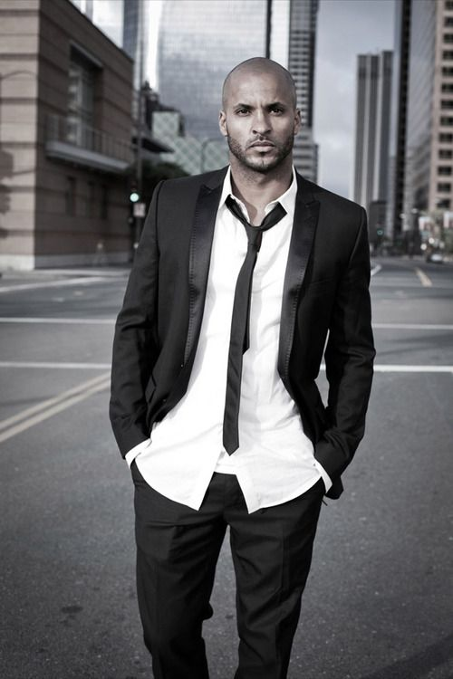 "Ricky Whittle as Warden ""He set fire to the poppies."""