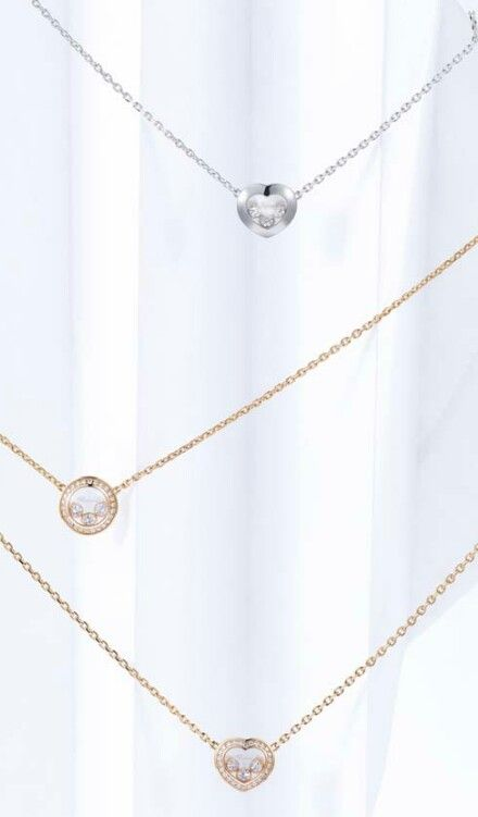 Chopard - necklaces from the Happy Curves collection in white or rose gold with either a circular or heart motif carrying three freely moving brilliant-cut diamonds.