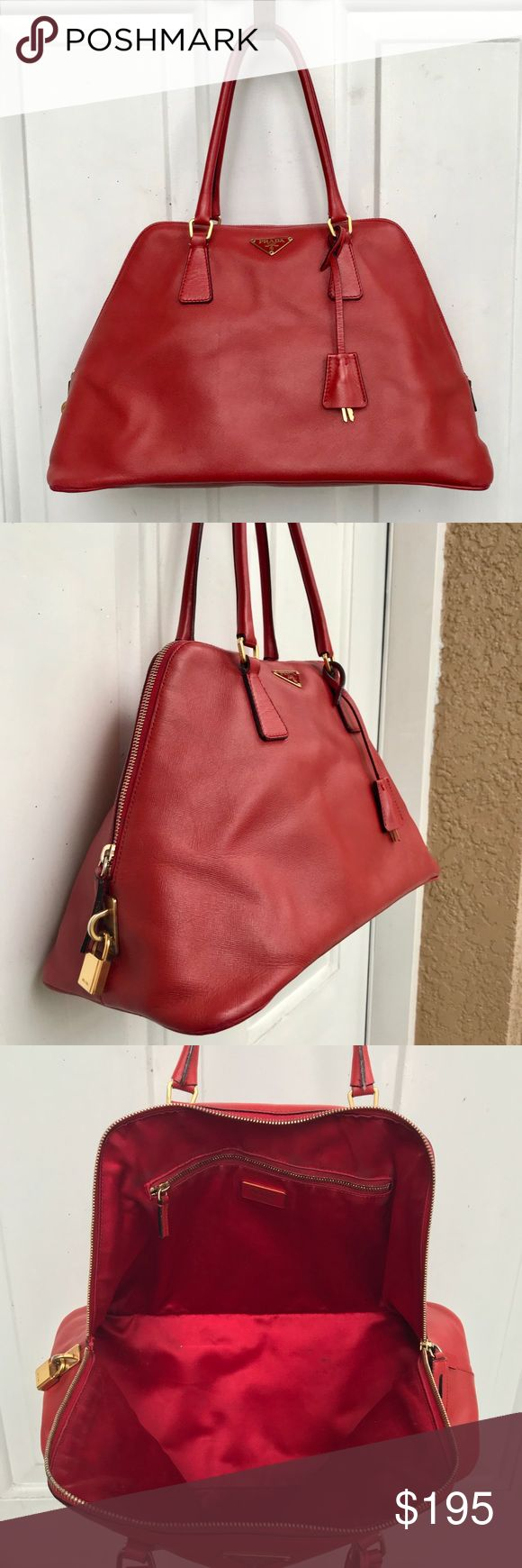 Vintage Prada Handbag Vintage Prada handbag still in great condition. I purchased this handbag at an estate sale. I do not know if it's a real Prada but the quality looks really good. Handbag has been used but looks pretty clean. If you have any questions please do not hesitate to ask. Thank you 😊 Prada Bags Satchels