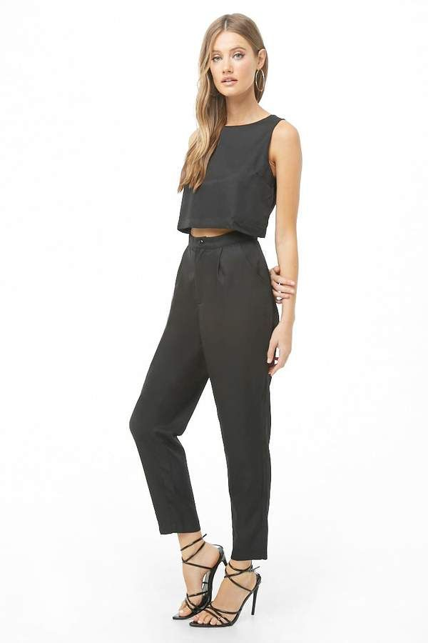 5d13d795984  42.00 - Forever 21 Sleeveless Cutout Jumpsuit in Black   Green colors - A  woven jumpsuit featuring a round neckline
