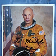 Autographed photo of Astronaut Story Musgrave    Fly me to the moon...