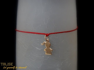 Lovely Red String Bracelet with a gold plated pendant in the shape of a cute little girl #red #string #charm #bracelet #pendant #gold #plated #girl #talise #jewelry