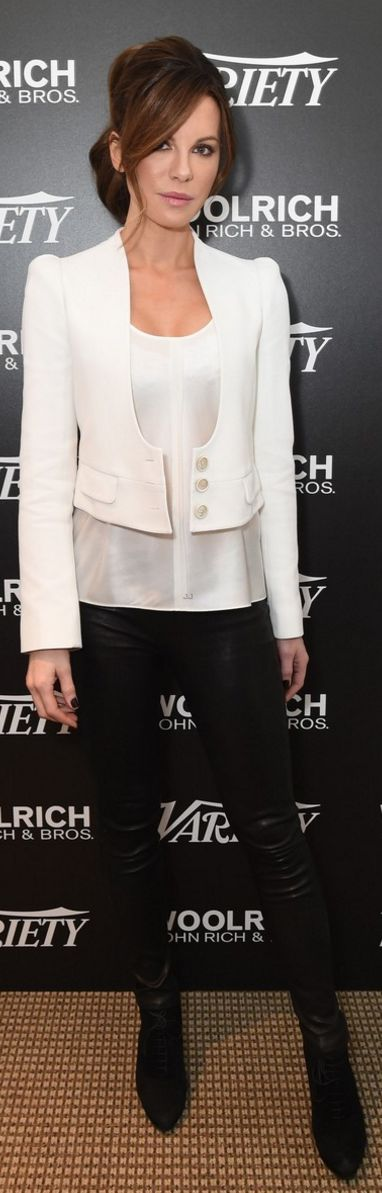 Who made  Kate Beckinsale's black suede boots, leather pants, and white jacket?